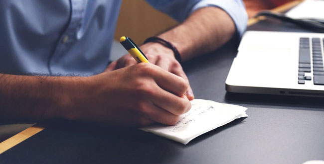Man taking notes about insurance plans
